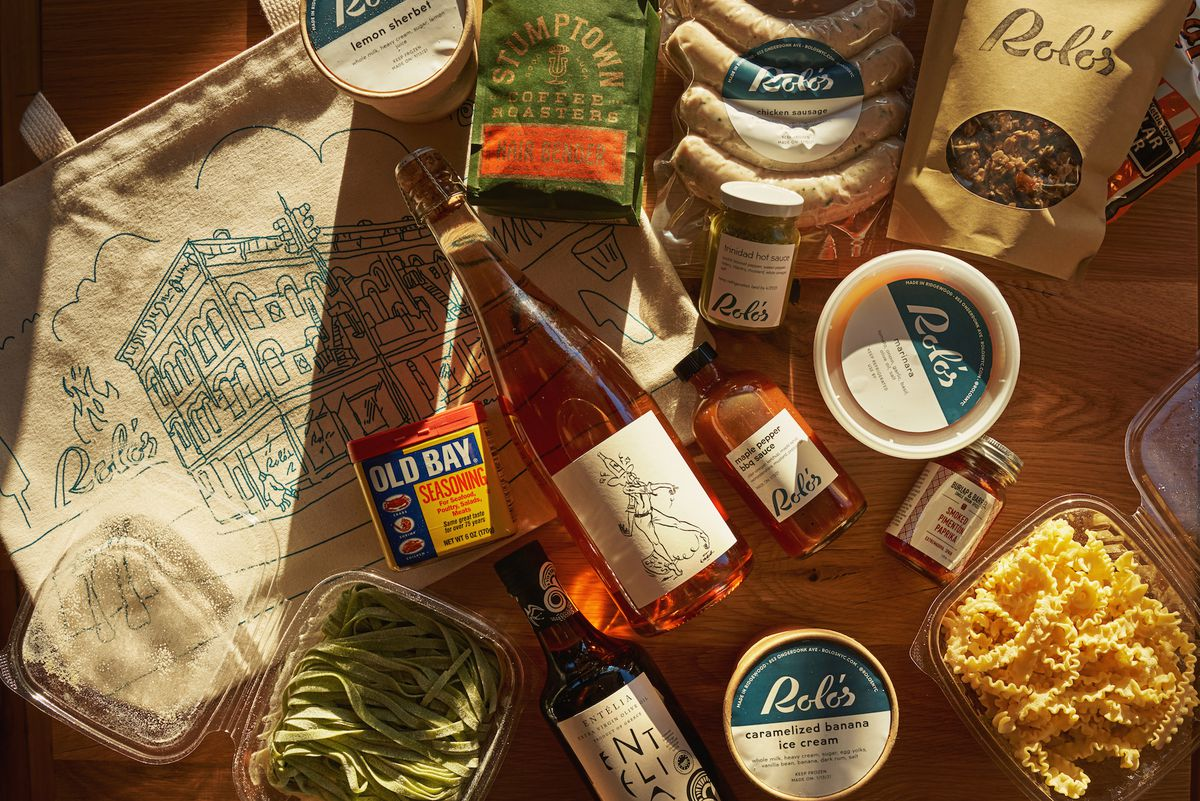 A selection of wine, fresh pasta, and sauces on a wooden table