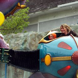 Riders enjoy Lagoon's newest ride, the OdySea, a spinning ride with a water element, on Wednesday.