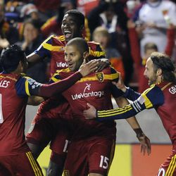 Real Salt Lake forward Alvaro Saborio (15) celebrates a goal with Real Salt Lake midfielder Javier Morales (11), who gets the assist, as teammates Real Salt Lake forward Olmes Garcia (13) and Real Salt Lake midfielder Ned Grabavoy (20) join in on the celebration during a game at Rio Tinto Stadium in Sandy on Saturday, March 29, 2014.