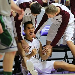 Lone Peak's Frank Jackson celebrates after being fouled and hitting the jumpshot as they play Copper Hills play Monday, Feb. 23, 2015, in the first round of the 5A boys basketball tournament at Weber State in Ogden. Lone Peak won 99-74.