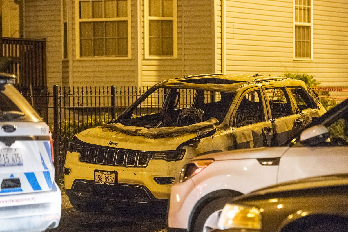 Police and Fire Department investigate a burned out vehicle that's related in a fatal shooting Sunday morning in the 4300 block of South Paulina. | Tyler LaRiviere/Sun-Times