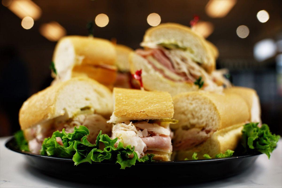 A spread of personal-sized deli sandwiches from Henri's Deli and Cafe