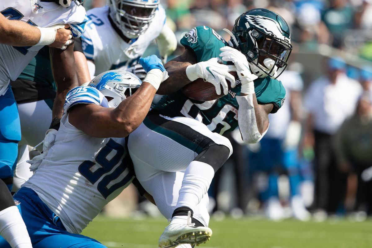 Philadelphia Eagles running back Miles Sanders is tackled by Detroit Lions defensive end Trey Flowers during the second quarter at Lincoln Financial Field.