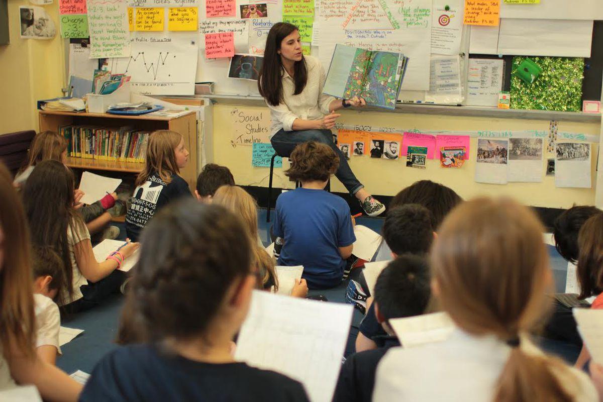 Lauren Bakian Aaker reads aloud to her fourth-grade students.