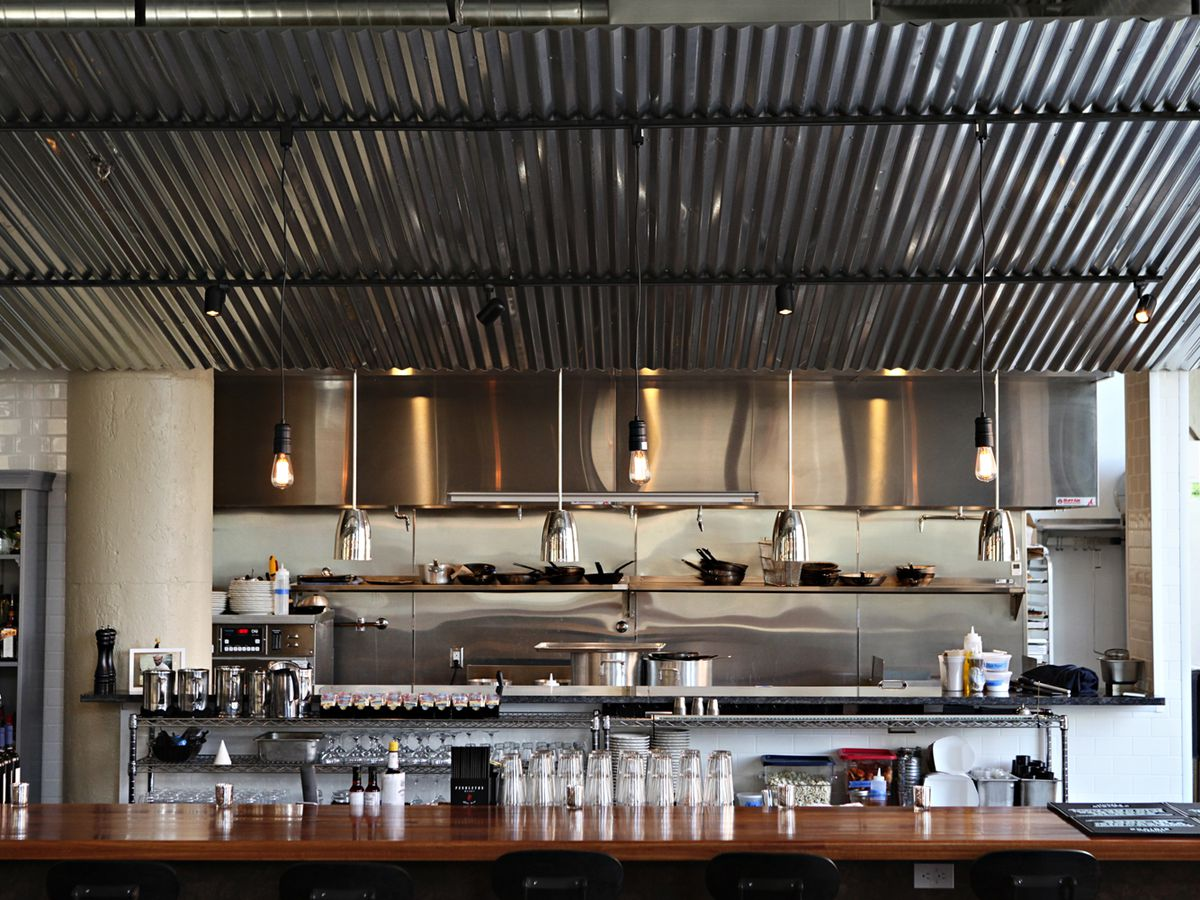 The bar at Saint Dinette, topped with a corrugated tin awning
