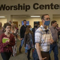 Worshippers leave after a church service at Kingsland Baptist Church in Katy, Texas, on Sunday, March 28, 2021.