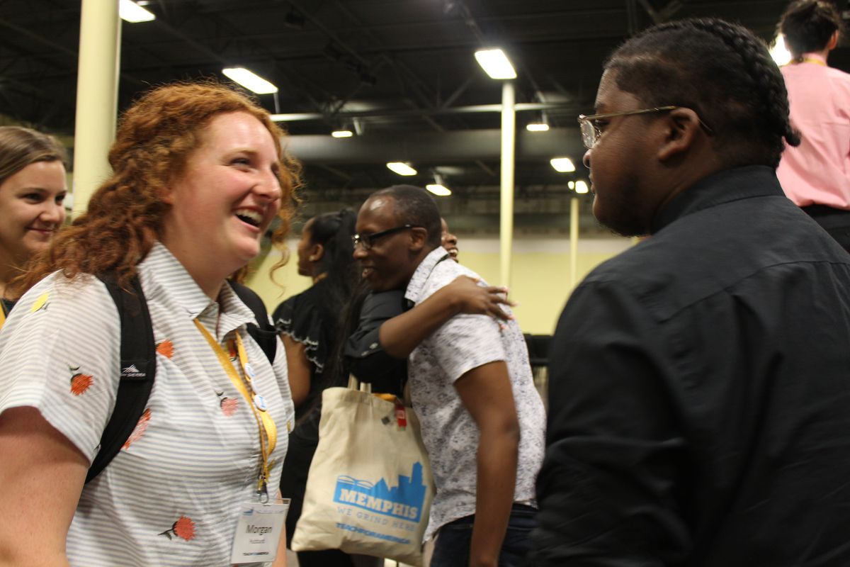 Corps members talk to and hug participants Evan Walsh and Detario Yancey after the discussion.