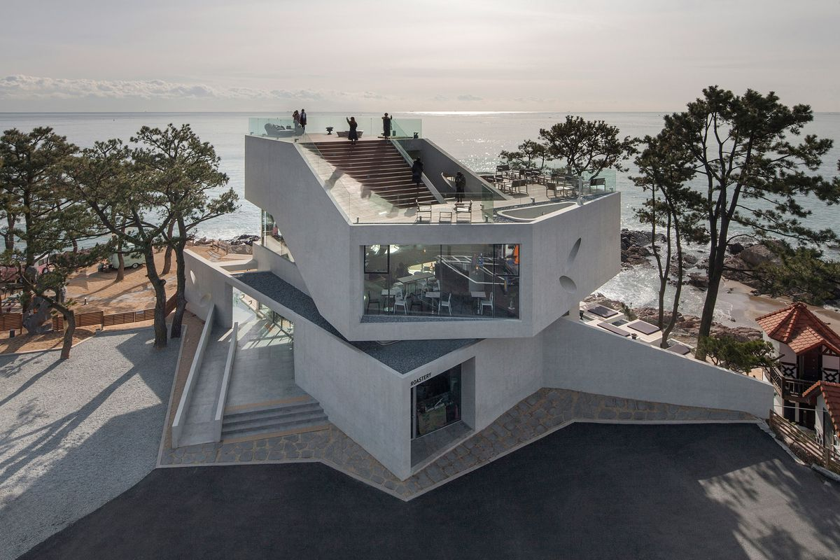 Angular concrete cafe frames stunning sea views in south for Angular 1 architecture