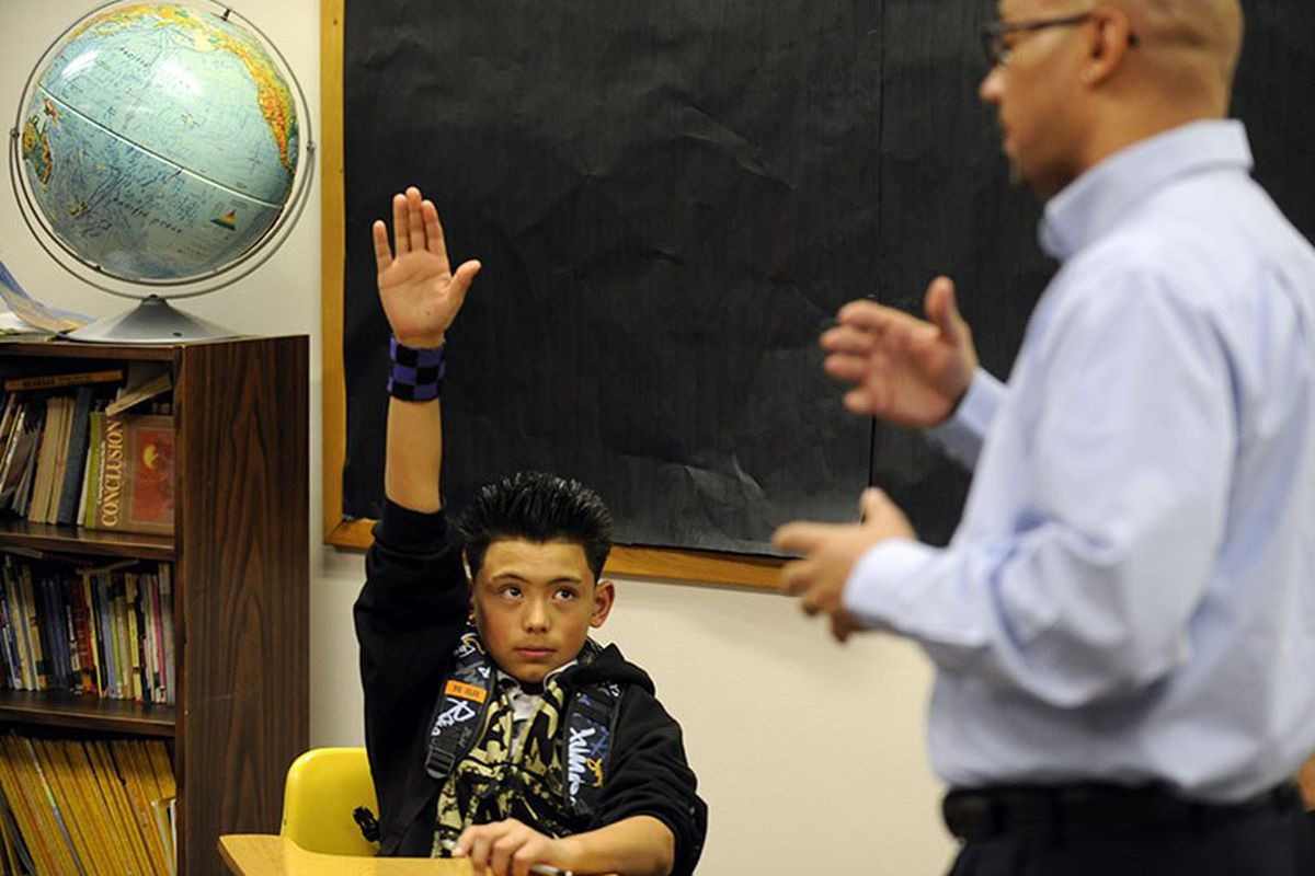 Jorge Robles, 12, raises his hand at Dr. Martin Luther King Jr. Early College in 2010.