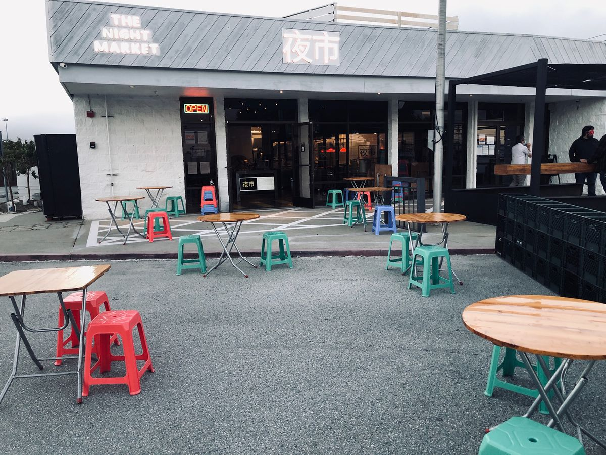 The restaurant has set up tables for outdoor dining in its parking lot