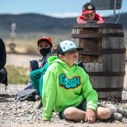Visitors watch as locomotives move along the track during a celebration marking the 152nd anniversary of the completion of the nation's first transcontinental railroad at Golden Spike National Historic Park in Corrine on Monday, May 10, 2021. Visitors gathered at the park to mark the anniversary and to watch a reenactment of the 1869 ceremony.