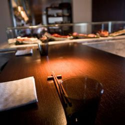 An intimate chef's table sits adjacent to the raw bar