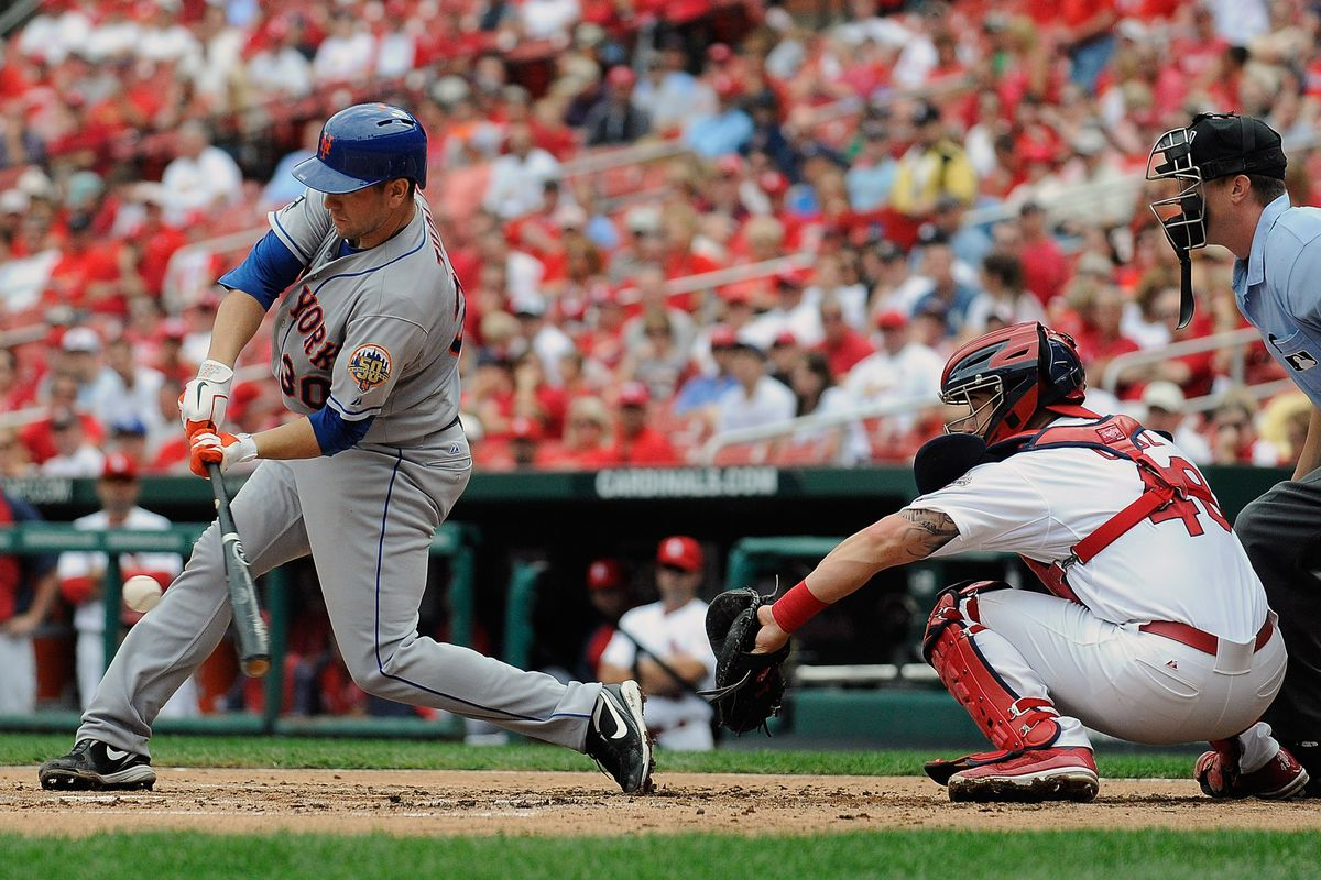 ST. LOUIS, MO - SEPTEMBER 5: Josh Thole #30 of the New York Mets hits a one run single against the St. Louis Cardinals at Busch Stadium on September 5, 2012 in St. Louis, Missouri. (Photo by Jeff Curry/Getty Images)