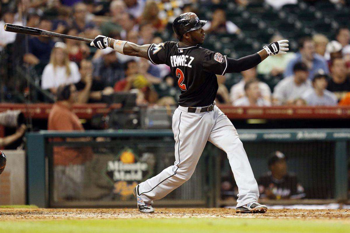 May 7, 2012; Houston, TX, USA; Miami Marlins third baseman Hanley Ramirez (2) hits a home run against the Houston Astros during the ninth inning at Minute Maid Park. The Marlins won 4-0. Mandatory Credit: Thomas Campbell-US PRESSWIRE