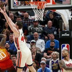 Utah Jazz guard Jordan Clarkson (00)attempts to score while Portland Trail Blazers forward Mario Hezonja (44) attempts to block him at Vivint Smart Home Arena in Salt Lake City on Friday, Feb. 7, 2020.