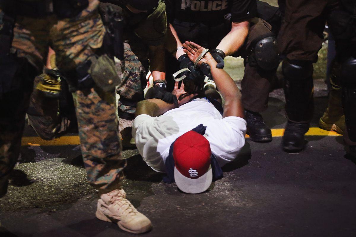 Police arrest a protester in Ferguson, Missouri.