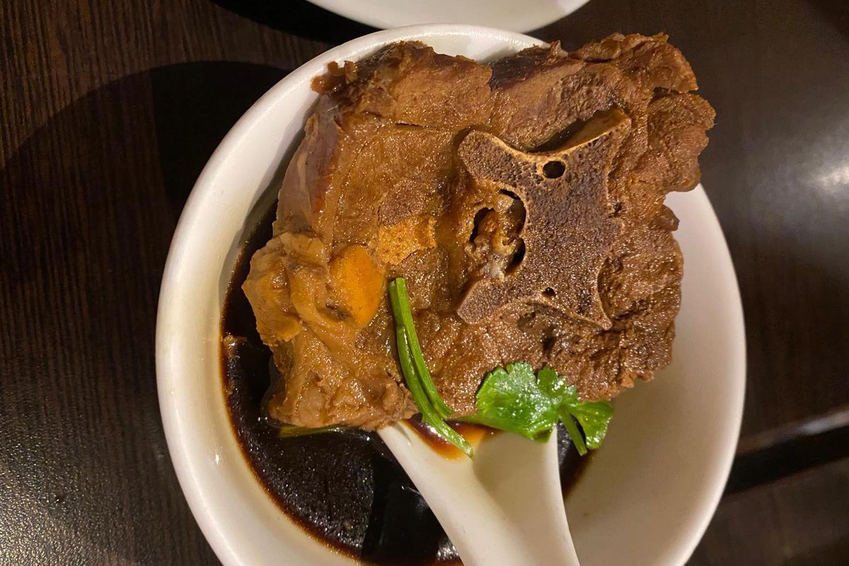 A lamb spine soup in a white bowl