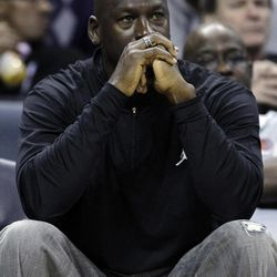 FILE - In this Jan. 16, 2012, file photo, Charlotte Bobcats owner Michael Jordan watches during the first half of an NBA basketball game between the Bobcats and the Cleveland Cavaliers in Charlotte, N.C. Jordan's No. 23 has long been synonymous with greatness. By Thursday night, that number could have a completely different meaning. If Jordan's Charlotte Bobcats lose to the New York Knicks, it will be their 23rd consecutive loss and they'll finish the season with the worst winning percentage in NBA history.