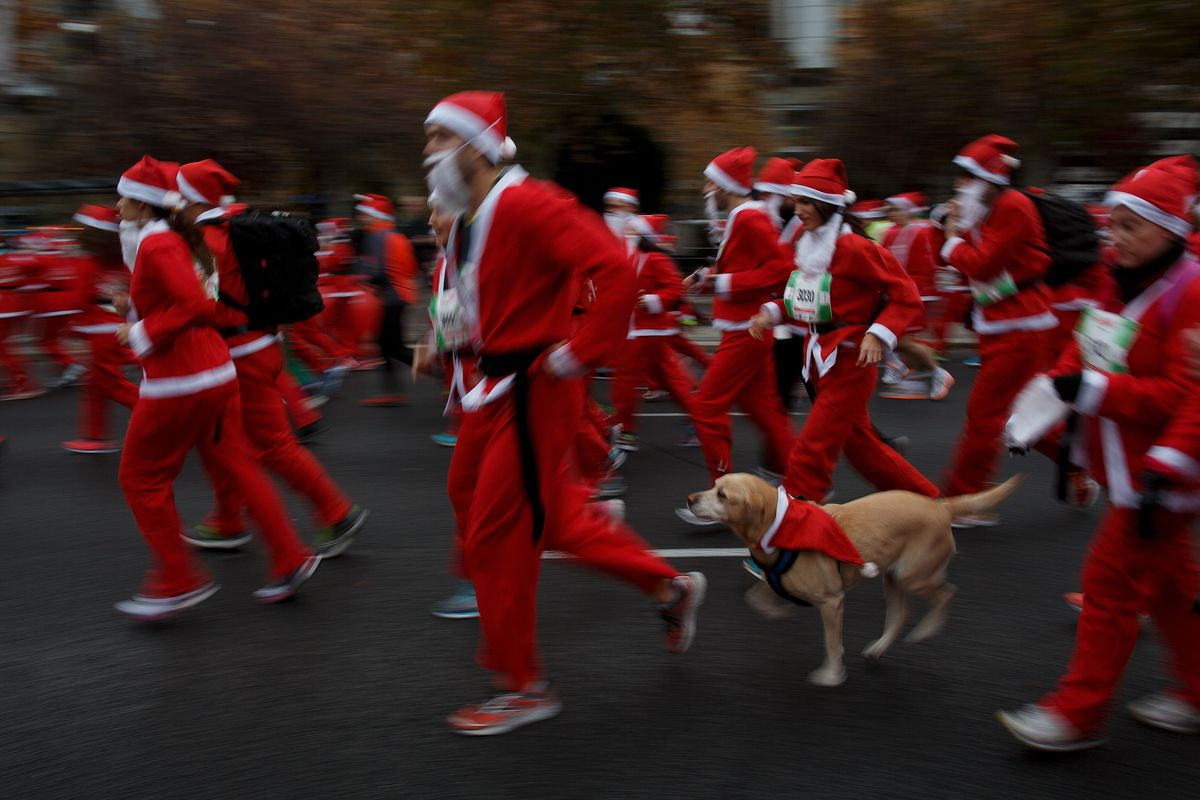 Thousands Dressed As Santa Claus Run In Madrid