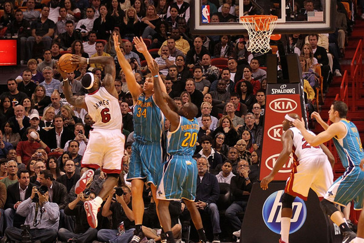 Aaron Gray, Quincey Pondexter, and Jason Smith trying to guard LeBron James. Guess how that turned out?