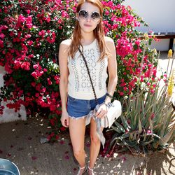 Emma Roberts in a Coach top, sandals, and bag, Levi's cutoffs, and Jimmy Choo sunglasses.