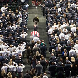 Unified police officer Doug Barney's casket is wheeled into the Maverik Center in West Valley City on Monday, Jan. 25, 2016.