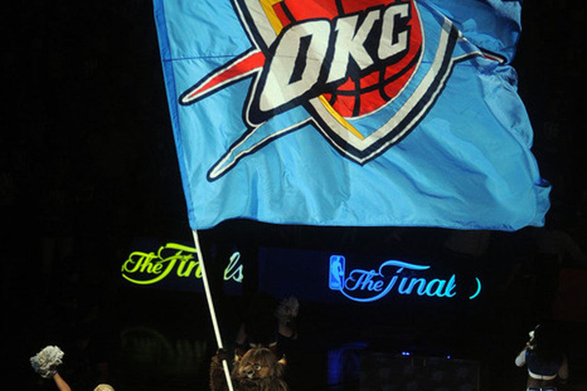 Jun 12, 2012; Oklahoma City, OK, USA;  The Oklahoma City Thunder mascot waves a flag on the court during the first quarter of game one in the 2012 NBA Finals at Chesapeake Energy Arena. Mandatory Credit: Mark D. Smith-US PRESSWIRE