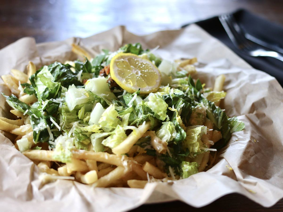 Holy Roller's Caesar salad with fries