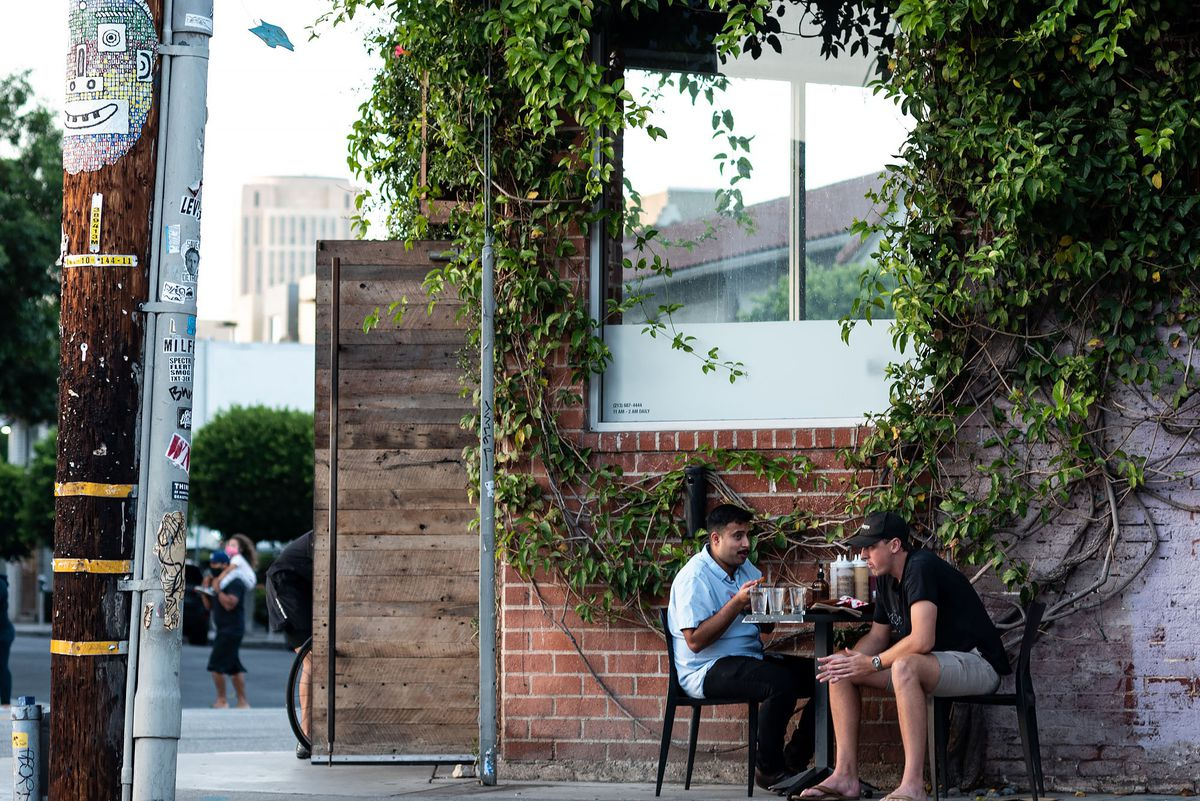 Diners sit on the street in Downtown's Arts District.