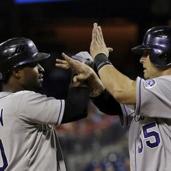 Colorado Rockies' Chris Nelson, left, and Ramon Hernandez celebrate after Nelson's three-run home run off Philadelphia Phillies starting pitcher Tyler Cloyd in the third inning of the second game of a baseball doubleheader on Sunday, Sept. 9, 2012, in Philadelphia.