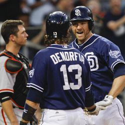 San Diego Padres' Chase Headley is congratulated by Chris Denorfia after hitting a two-run home run against the San Francisco Giants during the third inning of a baseball game Saturday, Sept. 29, 2012 in San Diego.