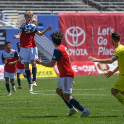 Thomas Roberts (23) chesting the ball during the opening match of the 40th Annual Dallas Cup.