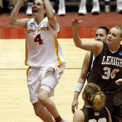 Alison Lacey (4) drives to the basket past Lehigh players during an Iowa State NCAA tournament win.