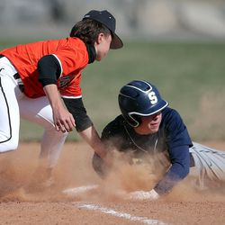 Murray's Trevor Dale tags Skyline's Aj Jones at third base during a high school baseball game in Murray at Ken Price Ballpark on Tuesday, March 30, 2021. Murray won 7-5.