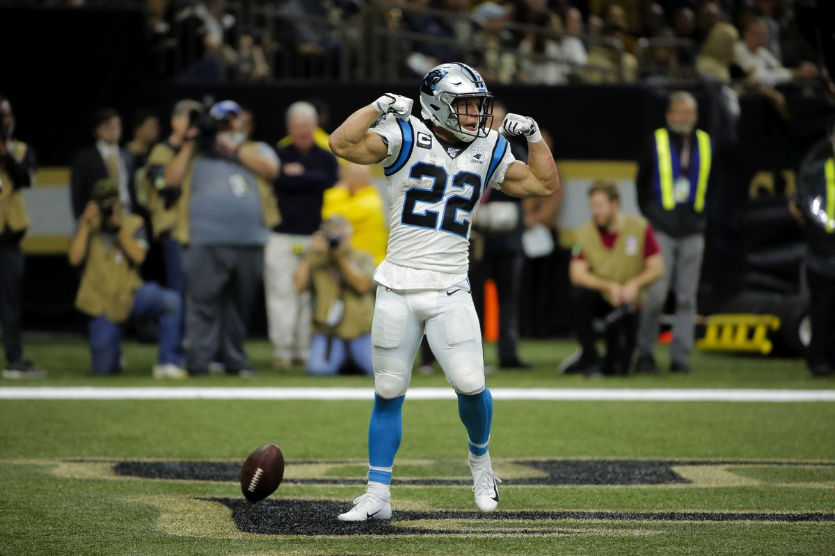 Carolina Panthers running back Christian McCaffrey celebrates after a touchdown against the New Orleans Saints during the second half at the Mercedes-Benz Superdome.