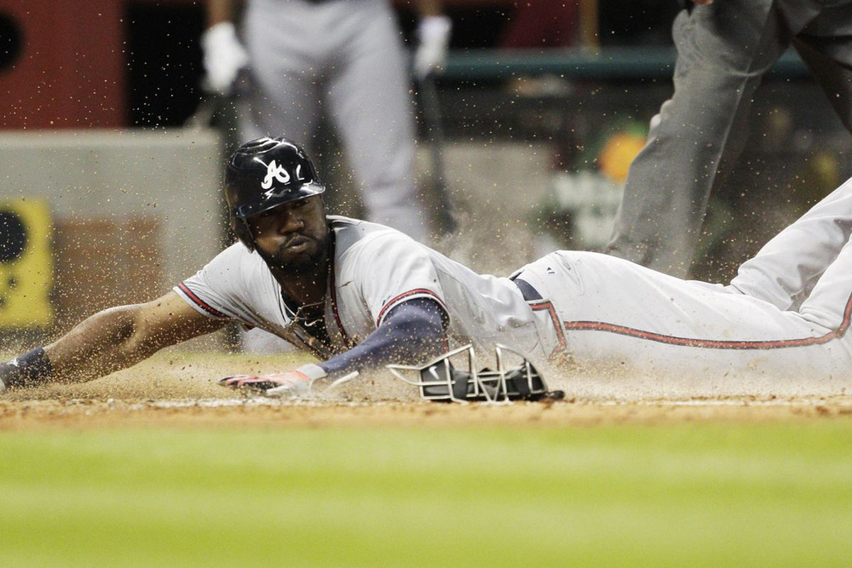 HOUSTON - APRIL 11:  Jason Heyward #2 of the Atlanta Braves scores in the fourth inning from third base on a bunt by Jack Wilson #2 against the Houston Astros at Minute Maid Park on April 11, 2012 in Houston, Texas.  (Photo by Bob Levey/Getty Images)