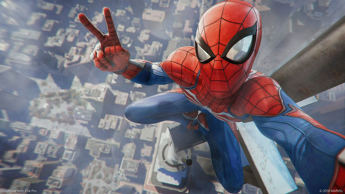 Spider-Man flashing the peace sign in a selfie from the antenna of the Empire State Building in Marvel's Spider-Man