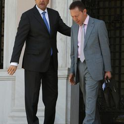 """Greece's Prime Minister Antonis Samaras, left, and Finance Minister Yannis Stournaras are seen after a meeting with the heads of the two junior coalition parties at Maximos Mansion in Athens, Thursday, Sept. 27, 2012. Stournaras says the heads of the three parties in the governing coalition have reached a """"basic agreement"""" on an austerity package for 2013-14.The cuts are essential if Greece is to continue receiving funds from international emergency loans."""
