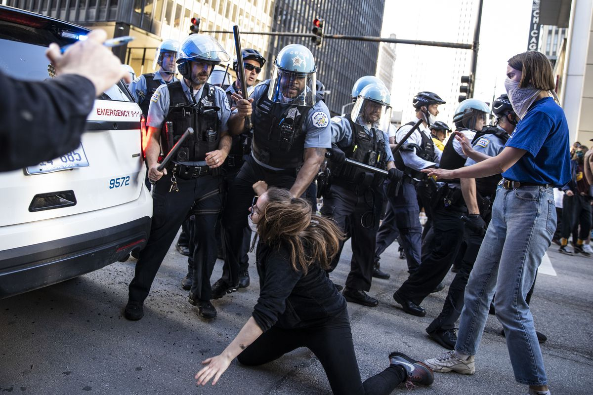 Chicago police officers clash with protesters near Kinzie and State as thousands in Chicago joined national outrage over the killing of George Floyd in Minneapolis police custody, Saturday afternoon, May 30, 2020.