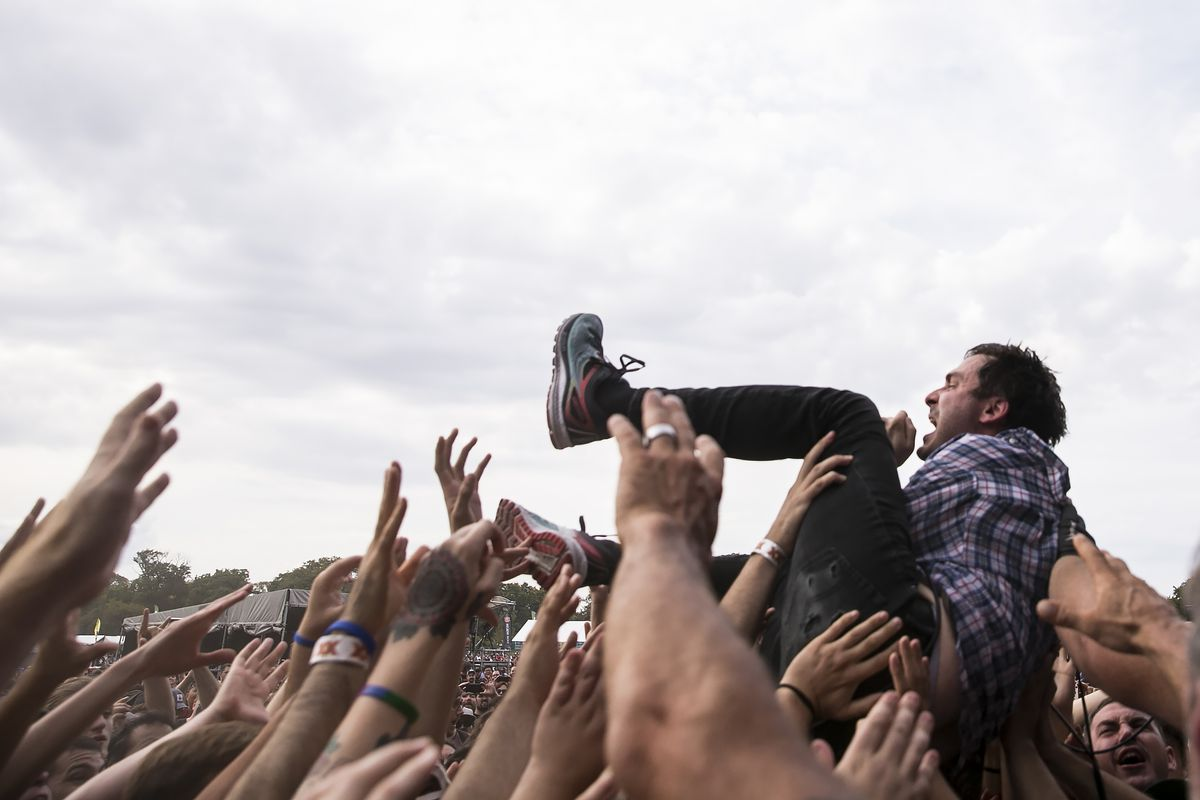 Tim Kinsella, of Cap'n Jazz, crowd surfs during his performance on day three of Riot Fest in Douglas Park, Sept. 16, 2017. | Ashlee Rezin/Sun-Times