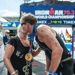 His mother Helen hands him his medal for completing the race.