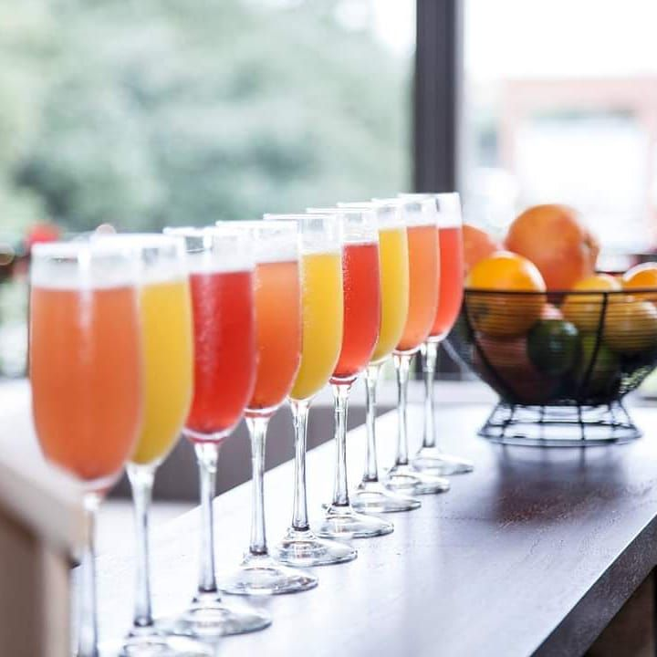 a flight of mimosas made with different brightly-colored juices