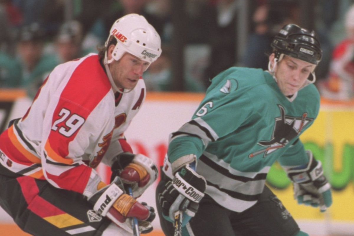 Alberta, Canada May 10, 1995: Sharks Sandis Ozolinsh,right, and Flames Joel Otto in second game. (Tom Van Dyke/San Jose Mercury News)