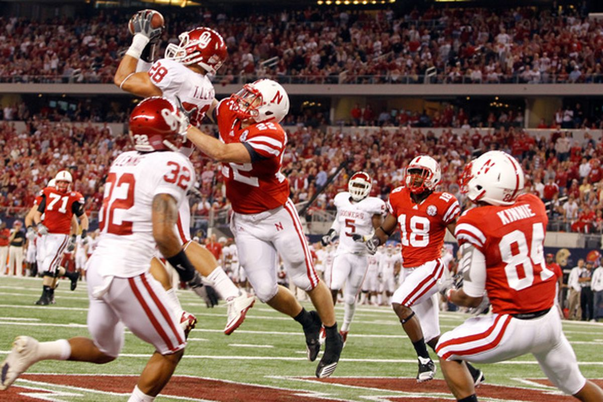 Bad interceptions of Taylor Martinez (like this one by Travis Lewis in the 2010 Big XII Championship Game) were a less frequent occurrence in the later stages of the 2011 season. (Photo by Tom Pennington/Getty Images)