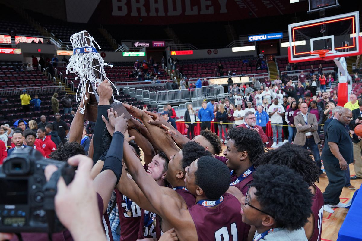 Belleville West celebrates its Class 4A state championship at the Peoria Civic Center.
