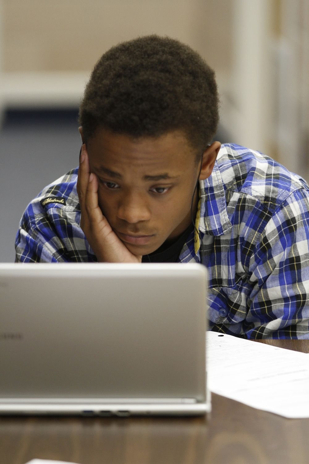 A Manual student works on his class assignment. Student scores on state exams dropped so low Denver Public Schools ranked Manual among its lowest performing schools.
