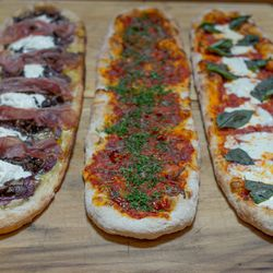 The pizzas, left to right: prosciutto and mushroom, Calabrian chili and anchovy and the margherita.