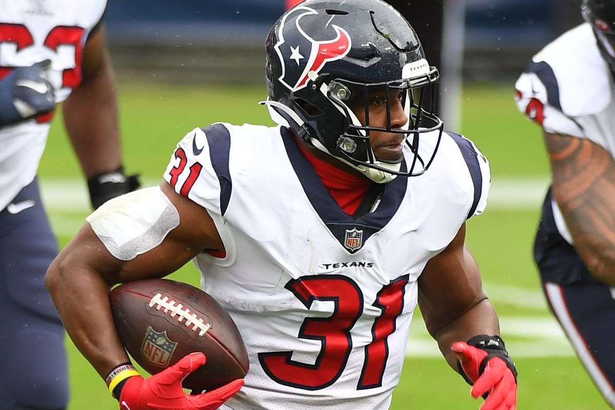Houston Texans running back David Johnson runs for a short gain during the second half against the Tennessee Titans at Nissan Stadium.