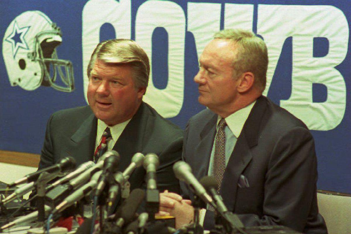 Jimmy Johnson (L) announces his resignation as hea