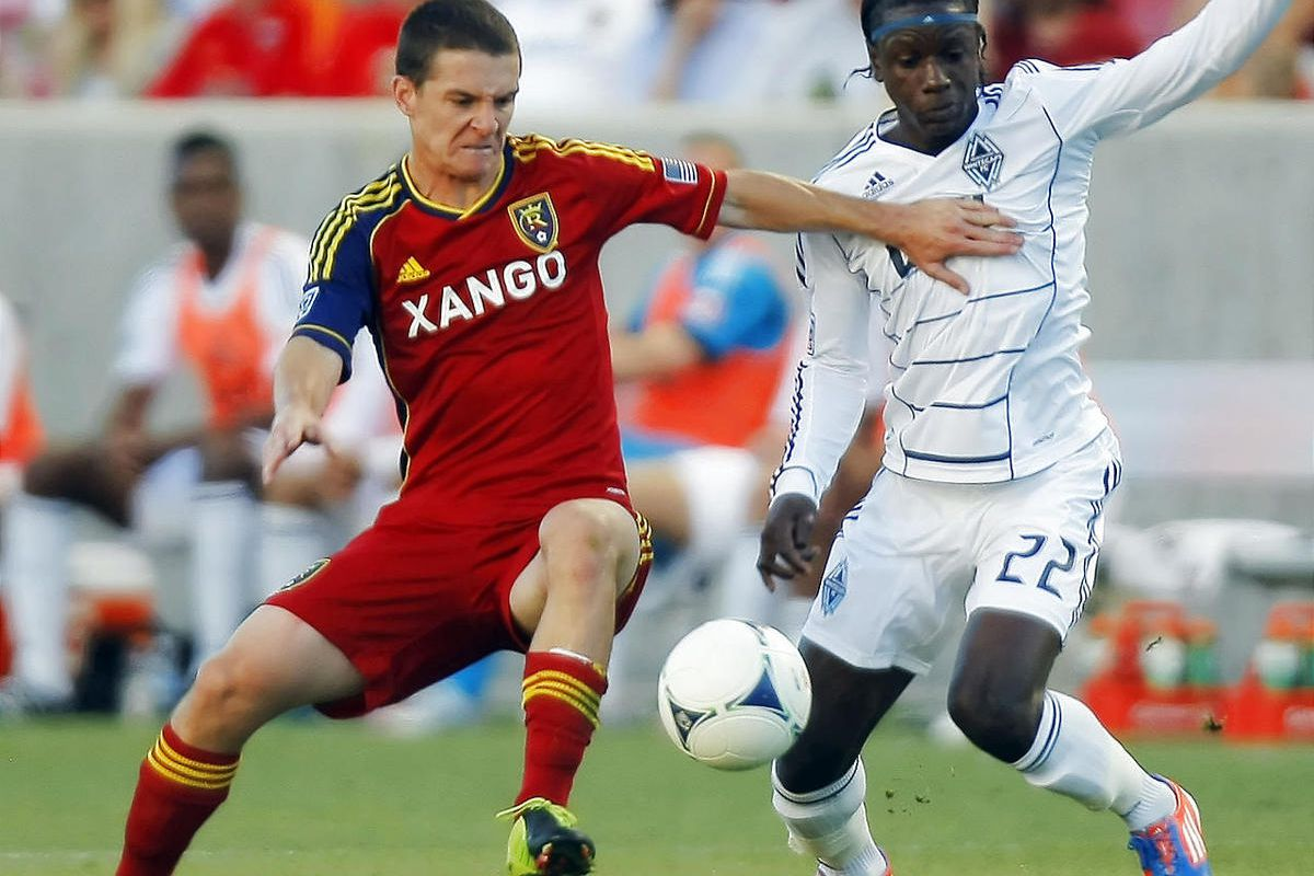 RSL's Will Johnson, left, has a busy month ahead of him with MLS league play, a Champions League game and World Cup qualifying. arren Mattocks for the ball as Real Salt Lake and Vancouver play Friday, July 27, 2012 at Rio Tinto Stadium.July 27, 2012 at Ri